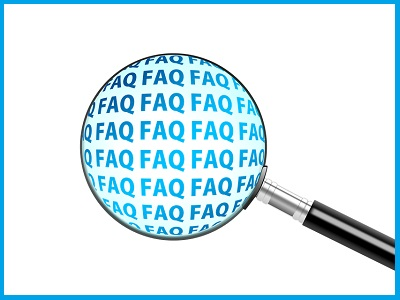 Una lente d'ingrandimento rende più evidente una parte del testo con su scritto FAQ